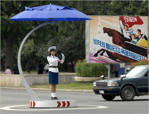An undated photograph released by North Korea's official news agency shows a woman directing traffic in Pyongyang on one of the new covered podiums found in intersections across the city, which has no traffic lights.  શું આપણે ત્યાં આવા Traffic Controllers હોય તો Traffic Controlમાં રહે ખરા?