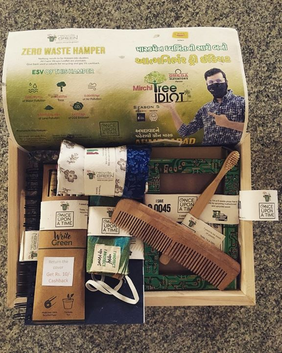 "આવી ગયું છે the most awaited 'Zero Waste Green Hamper'! It is specially created by Hardik Shah from Recycle.Green for you!   It is worth Rs.1700, but it's value is far more than that.   Features of the ""Zero Waste Hamper"" –   1. None of the articles need to be thrown in the dustbin. Additionally the articles are either upcycled or made of waste wood/denims etc. 2. Every article has a ""Once upon a time"" tag which shows the history of the article, which is quite interesting. 3. Every paper in the hamper is a seed paper. The type of seed is mentioned on each of them, even the backdrop has seeds in it. 4. ESV value – Environmental saving value is mentioned in the backdrop. Usage of the hamper will result in saving certain amount of Water, Tree, land etc.  આ ઝીરો વેસ્ટ ગ્રીન હેમ્પર હું તમને આપવાનો છું. State tuned!  Change ur life to green   #recycledotgreen #RjDhvanit #zerowastegreenhamper #RadioMirchi #MirchiGujarati #staytuned"